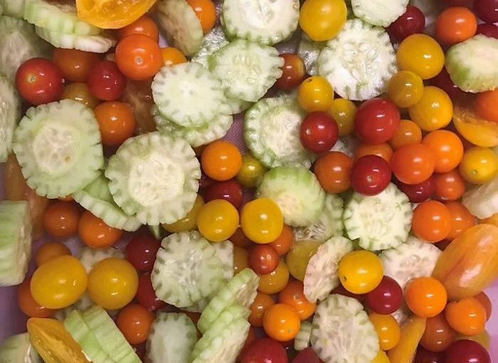 M. Foothills Fresh serving up organic, local cherry tomatoes and cucumbers from Mountain Bounty Farm, Riverhill Farm, and Food Love Farm!