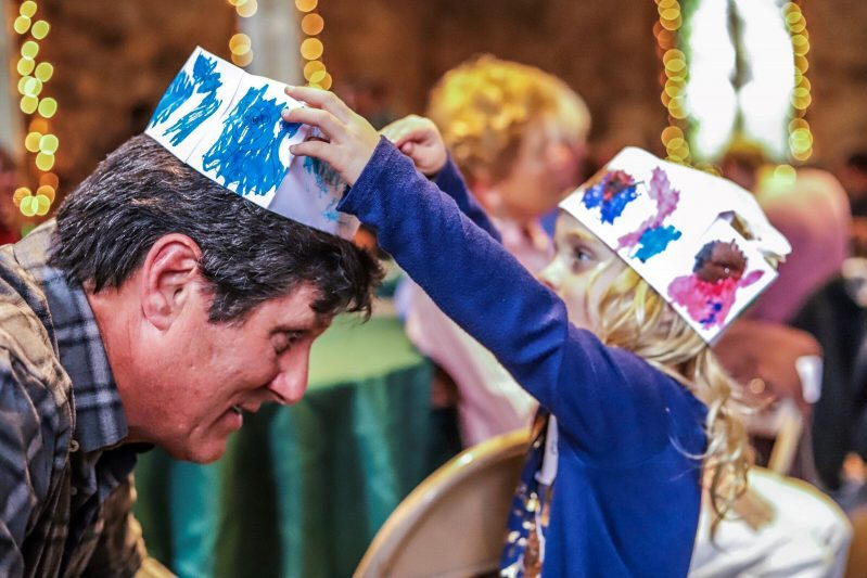 2019 - Roger Strong and granddaughter with chef hats at Soup Night - Jason Scallin photographer - media releases on file