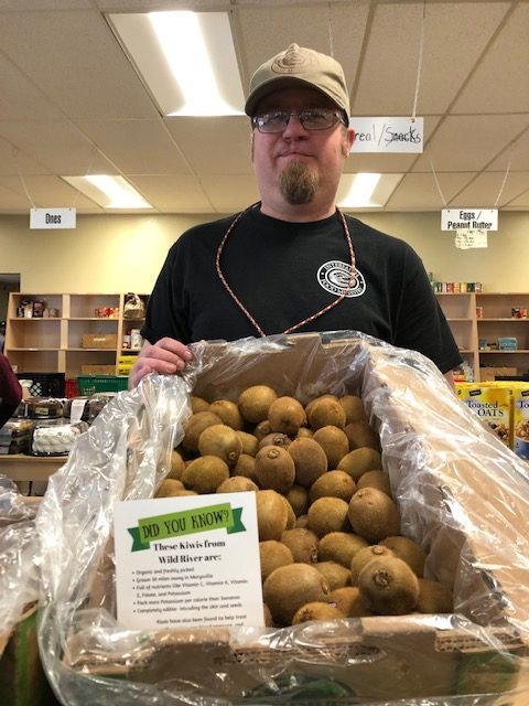 Phil Alonso, ED of Interfaith Food Ministry with organic kiwis purchased as part of the 20 x 25 challenge